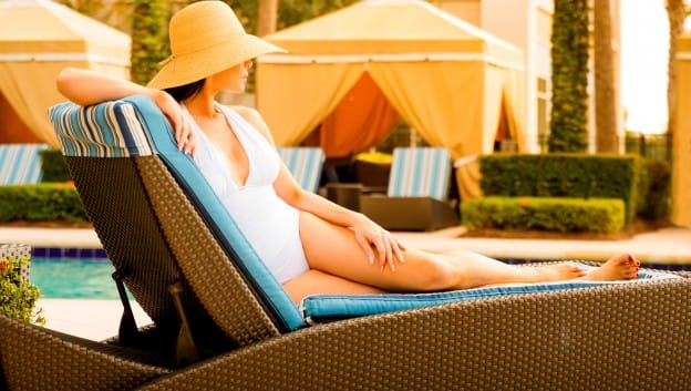 woman lounging by pool